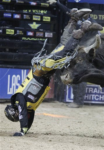 Mike Lee is thrown from Spit Fire during the final round of PBR World Finals rodeo Sunday, Oct. 30, 2011, in Las Vegas. &#40;AP Photo&#47;Isaac Brekken&#41; <span class=meta>(AP Photo&#47; Isaac Brekken)</span>