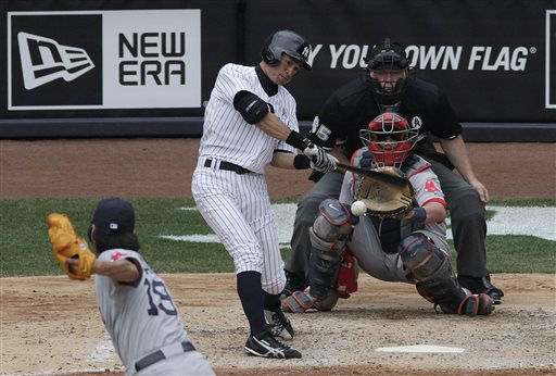 New York Yankees&#39; Ichiro Suzuki flies out against Boston Red Sox relief pitcher Koji Uehara in the sixth inning of a baseball game at Yankee Stadium, Monday, April 1, 2013 in New York. &#40;AP Photo&#47;Mark Lennihan&#41; <span class=meta>(AP Photo&#47; Mark Lennihan)</span>
