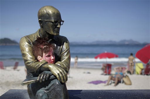 A doll&#39;s head sits in the lap of a statue of Brazilian poet Carlos Drummond de Andrade during the Zombie Walk in Rio de Janeiro, Brazil, Wednesday Nov.  2, 2011. Participants commemorated the Day of the Dead with the annual Zombie Walk. &#40;AP Photo&#47;Felipe Dana&#41; <span class=meta>(AP Photo&#47; Felipe Dana)</span>