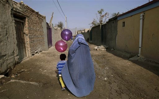 "<div class=""meta ""><span class=""caption-text "">An Afghan girl holds balloons while walking with her mother back home in an alley of a neighborhood in Kabul, Afghanistan, Wednesday, Nov. 2, 2011. (AP Photo/Muhammed Muheisen) (AP Photo/ Muhammed Muheisen)</span></div>"