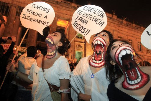 University students with their necks painted protest at Bolivar square in Bogota, Colombia, Thursday Nov. 3, 2011. Their signs read in Spanish &#34;We have the right to be outraged,&#34; left, and &#34;Excellent education and for all!!&#34;  Students are protesting education reforms planned by the government that propose private funding for public institutions.  &#40;AP Photo&#47;Fernando Vergara&#41; <span class=meta>(AP Photo&#47; Fernando Vergara)</span>
