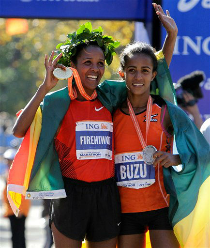 Firehiwot Dado, left, of Ethiopia, celebrates with countrywoman Buzunesh Deba after they finished in first and second place, respectively, among women in the New York City Marathon in New York, Sunday, Nov. 6, 2011. Deba lives in New York. &#40;AP Photo&#47;Kathy Willens&#41; <span class=meta>(AP Photo&#47; Kathy Willens)</span>