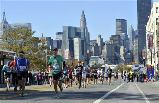 The New York City skyline is a backdrop for runners as they race down 44th Drive  in the borough of Queens during the New York City Marathon on Sunday, Nov. 6, 2011, in New York. &#40;AP Photo&#47;Kathy Kmonicek&#41; <span class=meta>(AP Photo&#47; Kathy Kmonicek)</span>