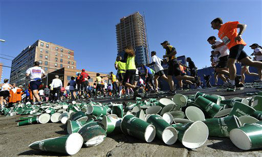 Empty cups from thirsty New York City Marathon runners fill Queens Plaza south on their way to the Queensboro Bridge in the borough of Queens on Sunday, Nov. 6, 2011, in New York. &#40;AP Photo&#47;Kathy Kmonicek&#41; <span class=meta>(AP Photo&#47; Kathy Kmonicek)</span>
