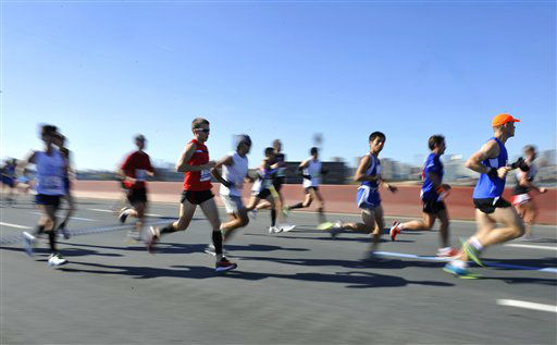Runners in the New York City Marathon cross the Pulaski Bridge in the borough of Queens on Sunday, Nov. 6, 2011, in New York. &#40;AP Photo&#47;Kathy Kmonicek&#41; <span class=meta>(AP Photo&#47; Kathy Kmonicek)</span>