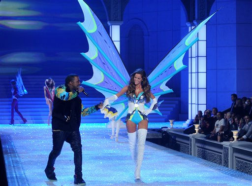 Kanye West holds a model&#39;s hand as he performs during the Victoria&#39;s Secret fashion show in New York, Wednesday, Nov. 9, 2011. &#40;AP Photo&#47;Brad Barket&#41; <span class=meta>(AP Photo&#47; Brad Barket)</span>