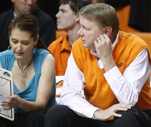 In this photo taken Nov. 9, 2011, Oklahoma State had coach Kurt Budke, right, sits on the bench next to assistant coach Miranda Serna, left, during an exhibition college basketball game against Fort Hays State in Stillwater, Okla. Budke and Serna were killed in a plane crash Thursday, Nov. 17, 2011, in Arkansas. &#40;AP Photo&#47;Sue Ogrocki&#41; <span class=meta>(AP Photo&#47; Sue Ogrocki)</span>