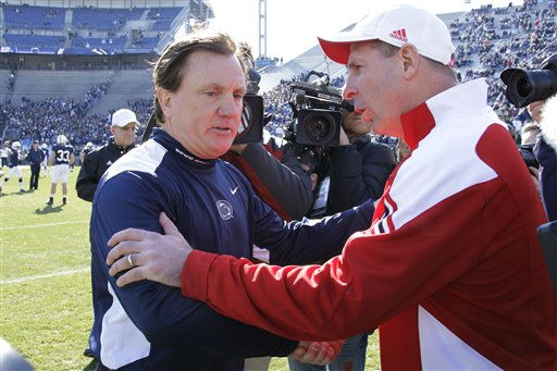Penn State interim head coach Tom Bradley, left, talks with Nebraska head coach Bo Pelini during warm ups before an NCAA college football game against Nebraska in State College, Pa., Saturday, Nov. 12, 2011. &#40;AP Photo&#47;Gene J. Puskar&#41; <span class=meta>(AP Photo&#47; Gene J. Puskar)</span>
