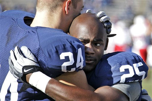 Penn State running backs Derek Day &#40;24&#41; and Silas Redd &#40;25&#41; embrace during warm ups before an  NCAA college football game against Nebraska at State College, Pa., Saturday, Nov. 12, 2011. &#40;AP Photo&#47;Gene J. Puskar&#41; <span class=meta>(AP Photo&#47; Gene J. Puskar)</span>