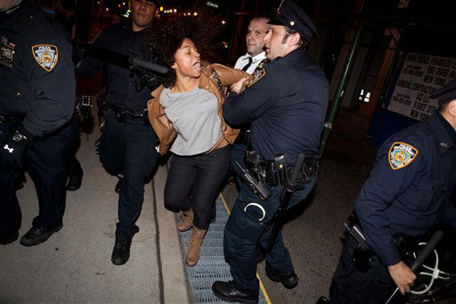 An Occupy Wall Street protestor is arrested during a march on Broadway, Tuesday, Nov. 15, 2011, in New York, after police ordered demonstrators to leave their encampment in Zuccotti Park. At about 1 a.m. Tuesday, police handed out notices from the park&#39;s owner, Brookfield Office Properties, and the city saying that the park had to be cleared because it had become unsanitary and hazardous. Protesters were told they could return, but without sleeping bags, tarps or tents. &#40;AP Photo&#47;John Minchillo&#41; <span class=meta>(AP Photo&#47; John Minchillo)</span>