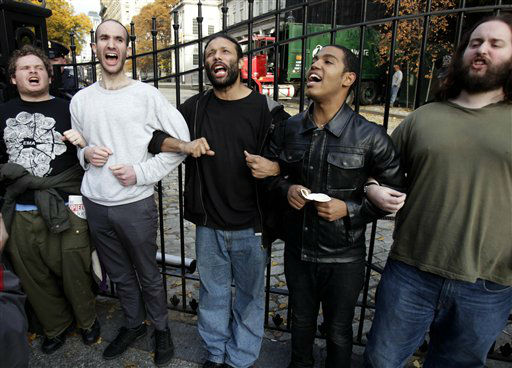 A group of Occupy Wall Street protesters blocking the entrance to City Hall,  react after hearing about a court order that would allow them to re-occupy Zuccotti Park in New York, Tuesday, Nov. 15, 2011.    The National Lawyers Guild obtained a court order allowing the protesters to return with their tents to the park, where they have camped for two months. The guild said the injunction prevents the city from enforcing park rules on the protesters.  &#40;AP Photo&#47;Seth Wenig&#41; <span class=meta>(AP Photo&#47; Seth Wenig)</span>