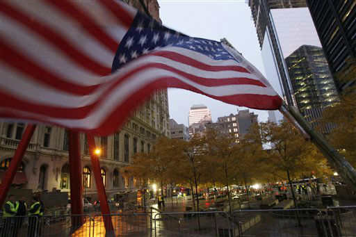 An American flag flies the empty Occupy Wall Street Encampment at Zuccotti Park  as dawn breaks, Tuesday, Nov. 15, 2011 in New York.   The National Lawyers Guild obtained a court order allowing the protesters to return with their tents to the park, where they have camped for two months. The guild said the injunction prevents the city from enforcing park rules on the protesters.  &#40;AP Photo&#47;Mary Altaffer&#41; <span class=meta>(AP Photo&#47; Mary Altaffer)</span>