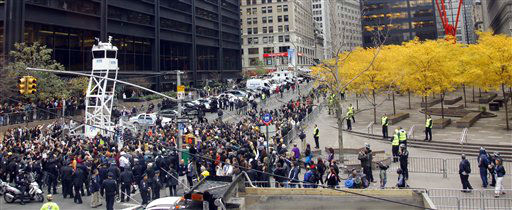Occupy Wall Street protesters return to Zuccotti Park on Tuesday, Nov. 15, 2011 in New York.  After an early police raid removing protesters, hundreds  returned to Zuccotti Park carrying photocopies of a court order they say gives them the right to return to the park.  The National Lawyers Guild obtained a court order allowing the protesters to return with their tents to the park, where they have camped for two months. The guild said the injunction prevents the city from enforcing park rules on the protesters.   &#40;AP Photo&#47;Bebeto Matthews&#41; <span class=meta>(AP Photo&#47; Bebeto Matthews)</span>