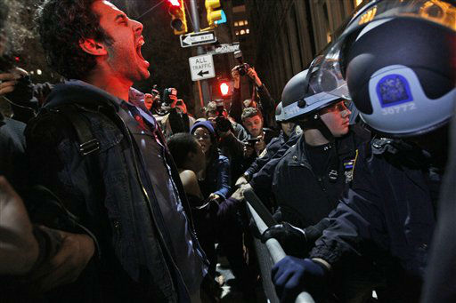 "<div class=""meta ""><span class=""caption-text "">An Occupy Wall Street protester yells out at police after being ordered to leave Zuccotti Park, their longtime encampment in New York, early Tuesday, Nov. 15, 2011. At about 1 a.m. Tuesday, police handed out notices from the park's owner, Brookfield Office Properties, and the city saying that the park had to be cleared because it had become unsanitary and hazardous. Protesters were told they could return, but without sleeping bags, tarps or tents. (AP Photo/Mary Altaffer) (AP Photo/ Mary Altaffer)</span></div>"