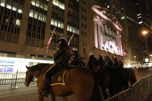 "<div class=""meta ""><span class=""caption-text "">Police officers stand guard outside the New York Stock Exchange,  Thursday, Nov. 17, 2011 in New York. Two days after the encampment that sparked the global Occupy movement was cleared by authorities, demonstrators in New York City and around the country were promising mass gatherings Thursday in support of the cause.  (AP Photo/Mary Altaffer) (AP Photo/ Mary Altaffer)</span></div>"