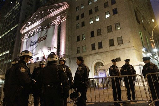 Police officers stand guard outside the New York Stock Exchange,  Thursday, Nov. 17, 2011 in New York. Two days after the encampment that sparked the global Occupy movement was cleared by authorities, demonstrators in New York City and around the country were promising mass gatherings Thursday in support of the cause.  &#40;AP Photo&#47;Mary Altaffer&#41; <span class=meta>(AP Photo&#47; Mary Altaffer)</span>