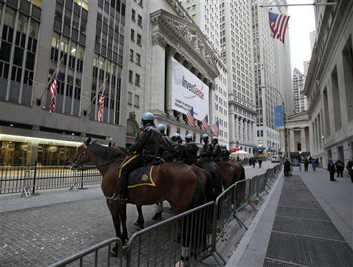 "<div class=""meta image-caption""><div class=""origin-logo origin-image ""><span></span></div><span class=""caption-text"">New York City Police mounted officers assemble on Broad Street in front of the New York Stock Exchange, background center, Thursday, Nov. 17, 2011, to guard against part of a planned nationwide protest marking two months since the Occupy Wall Street movement began. (AP Photo/Richard Drew) (AP Photo/ Richard Drew)</span></div>"