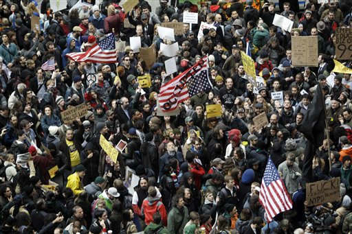 "<div class=""meta image-caption""><div class=""origin-logo origin-image ""><span></span></div><span class=""caption-text"">Demonstrators affiliated with the Occupy Wall Street movement assemble across the street from Zuccotti Park before marching through the streets of the financial district,  Thursday, Nov. 17, 2011 in New York.   Two days after the encampment that sparked the global Occupy protest movement was cleared by authorities, demonstrators marched through New York's financial district  and promised a national day of action with mass gatherings in other cities.   (AP Photo/Mary Altaffer) (AP Photo/ Mary Altaffer)</span></div>"