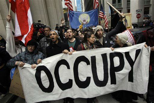 Demonstrators affiliated with the Occupy Wall Street movement march through the streets of the financial district,  Thursday, Nov. 17, 2011 in New York.   Two days after the encampment that sparked the global Occupy protest movement was cleared by authorities, demonstrators marched through New York&#39;s financial district  and promised a national day of action with mass gatherings in other cities.   &#40;AP Photo&#47;Mary Altaffer&#41; <span class=meta>(AP Photo&#47; Mary Altaffer)</span>