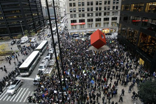 "<div class=""meta ""><span class=""caption-text "">Demonstrators affiliated with the Occupy Wall Street movement assemble across the street from Zuccotti Park before marching through the streets of the financial district,  Thursday, Nov. 17, 2011 in New York.   Two days after the encampment that sparked the global Occupy protest movement was cleared by authorities, demonstrators marched through New York's financial district  and promised a national day of action with mass gatherings in other cities.  (AP Photo/Mary Altaffer) (AP Photo/ Mary Altaffer)</span></div>"