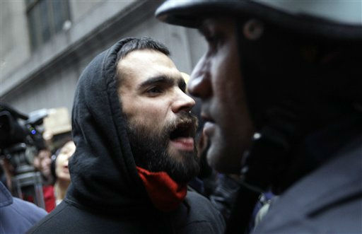 "<div class=""meta ""><span class=""caption-text "">Demonstrators affiliated with the Occupy Wall Street movement confront a police officer as they march through the streets of the financial district,  Thursday, Nov. 17, 2011 in New York.  Two days after the encampment that sparked the global Occupy protest movement was cleared by authorities, demonstrators marched through New York's financial district  and promised a national day of action with mass gatherings in other cities.   (AP Photo/Mary Altaffer) (AP Photo/ Mary Altaffer)</span></div>"