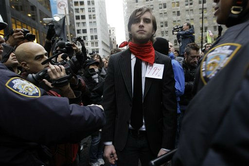 "<div class=""meta ""><span class=""caption-text "">Spencer Gray, of Brooklyn confronts police officers as he and other demonstrators affiliated with the Occupy Wall Street movement march through the streets of the financial district,  Thursday, Nov. 17, 2011 in New York.   Two days after the encampment that sparked the global Occupy protest movement was cleared by authorities, demonstrators marched through New York's financial district  and promised a national day of action with mass gatherings in other cities.  (AP Photo/Mary Altaffer) (AP Photo/ Mary Altaffer)</span></div>"