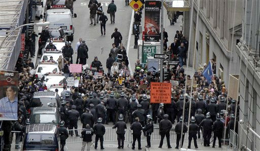 "<div class=""meta image-caption""><div class=""origin-logo origin-image ""><span></span></div><span class=""caption-text"">New York City Police officers prevent protestors from entering Wall Street from the east, Thursday, Nov. 17, 2011. Two days after the encampment that sparked the global Occupy protest movement was cleared by authorities, demonstrators marched through New York's financial district Thursday and promised a national day of action with mass gatherings in other cities. (AP Photo/Richard Drew) (AP Photo/ Richard Drew)</span></div>"