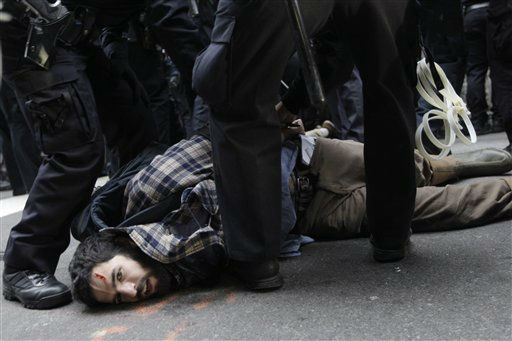 "<div class=""meta image-caption""><div class=""origin-logo origin-image ""><span></span></div><span class=""caption-text"">Police officers arrest a demonstrator affiliated with the Occupy Wall Street movement Thursday, Nov. 17, 2011 in New York. Hundreds of Occupy demonstrators marched through New York's financial district and staged sit-ins in the streets near the New York Stock Exchange, promising a national day of action with mass gatherings in other cities. (AP Photo/Mary Altaffer) (AP Photo/ Mary Altaffer)</span></div>"