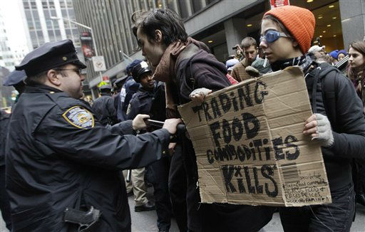 "<div class=""meta ""><span class=""caption-text "">A police officer shoves demonstrators affiliated with the Occupy Wall Street movement as they block an entrance to the New York Stock Exchange, Thursday, Nov. 17, 2011 in New York.   Two days after the encampment that sparked the global Occupy protest movement was cleared by authorities, demonstrators marched through New York's financial district  and promised a national day of action with mass gatherings in other cities.  (AP Photo/Mary Altaffer) (AP Photo/ Mary Altaffer)</span></div>"
