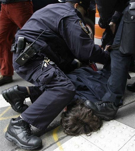 A police officer steps on the head of a demonstrator affiliated with the Occupy Wall Street movement as another assists in arresting him Thursday, Nov. 17, 2011 in New York. &#40;AP Photo&#47;Mary Altaffer&#41; <span class=meta>(AP Photo&#47; Mary Altaffer)</span>