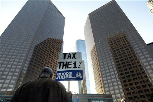 "<div class=""meta ""><span class=""caption-text "">An Occupy Los Angeles protester holds a sign as he walks down the steps during a rally in Los Angeles, Thursday, Nov. 17, 2011. About 100 protesters, chiefly a coalition of labor unions, gathered Thursday morning outside the Bank of America tower on Hope and 3rd streets and marched in a circle chanting ""Banks got bailed out, we got sold out.""  (AP Photo/Jae C. Hong) (AP Photo/ Jae C. Hong)</span></div>"
