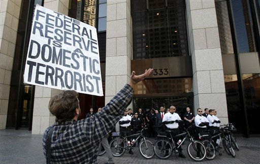 "<div class=""meta ""><span class=""caption-text "">An Occupy Los Angeles protester yells at security guards and police officers during a rally in Los Angeles, Thursday, Nov. 17, 2011.  Protesters plan to march to offices of Bank of America and JPMorgan Chase & Co.  (AP Photo/Jae C. Hong) (AP Photo/ Jae C. Hong)</span></div>"