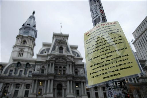 "<div class=""meta ""><span class=""caption-text "">An official notice is posted at the Occupy Philly encampment at City Hall, Thursday, Nov. 17, 2011, in Philadelphia.   Philadelphia officials have told protesters camping out next to City Hall to leave because of the ""imminent"" start of a long-planned renovation project.  (AP Photo/Matt Rourke) (AP Photo/ Matt Rourke)</span></div>"