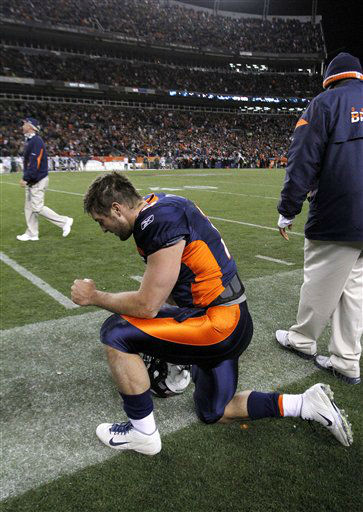 Denver Broncos&#39; Tim Tebow &#40;15&#41; kneels on the sideline after scoring the game winning touchdown beating the New York Jets 17-13 during the fourth quarter of an NFL football game, Thursday, Nov. 17, 2011, in Denver. &#40;AP Photo&#47;Barry Gutierrez&#41; <span class=meta>(AP Photo&#47; Barry Gutierrez)</span>