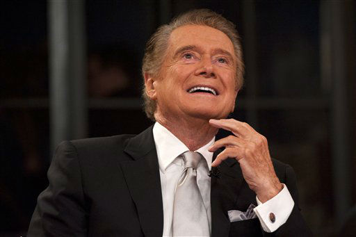 Regis Philbin shares a laugh during his farewell episode of &#34;Live! with Regis and Kelly&#34;, in New York, Friday, Nov. 18, 2011.  After more then  28 years, Philbin signed off U.S. morning television on Friday, long after setting a world record for the most time on TV.   Philbin,  80,  has logged more than 17,000 hours on television in a career that dates back to the 1960s. He gained prime-time fame as host of &#34;Who Wants to Be a Millionaire&#34; a decade ago. But his enduring impact was as a morning show host, turning stories about something as simple as a dinner out on the town into compelling viewing.   &#40;AP Photo&#47;Charles Sykes&#41; <span class=meta>(AP Photo&#47; Charles Sykes)</span>