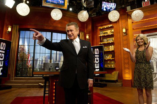 "<div class=""meta image-caption""><div class=""origin-logo origin-image ""><span></span></div><span class=""caption-text"">Regis Philbin and Kelly Ripa appear on Regis' farewell episode of ""Live! with Regis and Kelly"", in New York, Friday, Nov. 18, 2011.    After more then  28 years, Philbin signed off U.S. morning television on Friday, long after setting a world record for the most time on TV.   Philbin,  80,  has logged more than 17,000 hours on television in a career that dates back to the 1960s. He gained prime-time fame as host of ""Who Wants to Be a Millionaire"" a decade ago. But his enduring impact was as a morning show host, turning stories about something as simple as a dinner out on the town into compelling viewing.   (AP Photo/Charles Sykes) (AP Photo/ Charles Sykes)</span></div>"