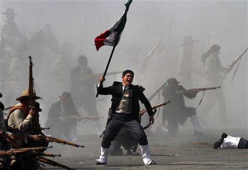 Soldiers re-enact a revolution battle as part of Mexican Revolution 101th anniversary celebrations in Mexico City&#39;s Zocalo plaza, Sunday Nov. 20, 2011. Mexico marks 101 years since the seven-year conflict began on Nov. 20, 1910 that saw peasant armies led by heroes Emiliano Zapata and Pancho Villa topple the dictatorship of Porfirio Diaz. &#40;AP Photo&#47;Marco Ugarte&#41; <span class=meta>(AP Photo&#47; Marco Ugarte)</span>