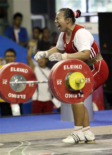 Indonesia&#39;s Novita Sherly celebrates after lifting 123 kilograms in the clean and jerk of the women&#39;s &#43; 69 kilogram weightlifting at the 26th Southeast Asian &#40;SEA&#41; Games in Palembang, South Sumatra, Indonesia, Monday, Nov. 21, 2011. &#40;AP Photo&#47;Achmad Ibrahim&#41; <span class=meta>(AP Photo&#47; Achmad Ibrahim)</span>