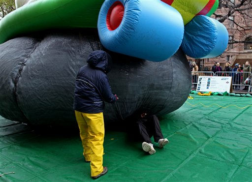 "<div class=""meta ""><span class=""caption-text "">A technician works on the undercarriage of the Kool-Aid Man balloon as they prepare for the 85th annual Macy's Thanksgiving Day Parade ,Wednesday, Nov. 23, 2011, in New York. (AP Photo/Craig Ruttle) (AP Photo/ Craig Ruttle)</span></div>"