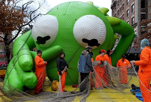 The Kermit the Frog balloon seems to reach out towards balloon handlers with Macy&#39;s department store&#39;s 85th annual Macy&#39;s Thanksgiving Day Parade as they work on another one of 15 giant helium balloons and 44 novelty and specialty balloons Wednesday, Nov. 23, 2011 that will be featured in Thursday&#39;s parade in New York. &#40;AP Photo&#47;Craig Ruttle&#41; <span class=meta>(AP Photo&#47; Craig Ruttle)</span>