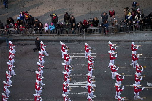 A marching band marches through Time Square during the Macy&#39;s Thanksgiving Day Parade in New York on Thursday, Nov. 24, 2011. The parade premiered in 1924, this is its 85th year. &#40;AP Photo&#47;Andrew Burton&#41; <span class=meta>(AP Photo&#47; Andrew Burton)</span>