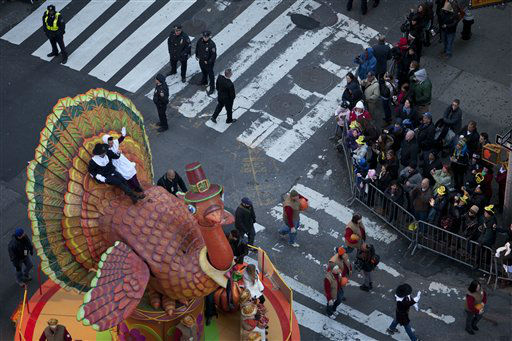 "<div class=""meta ""><span class=""caption-text "">People watch the Macy's Thanksgiving Day Parade in Time Square in New York on Thursday, Nov. 24, 2011. The parade premiered in 1924, this is its 85th year. (AP Photo/Andrew Burton) (AP Photo/ Andrew Burton)</span></div>"