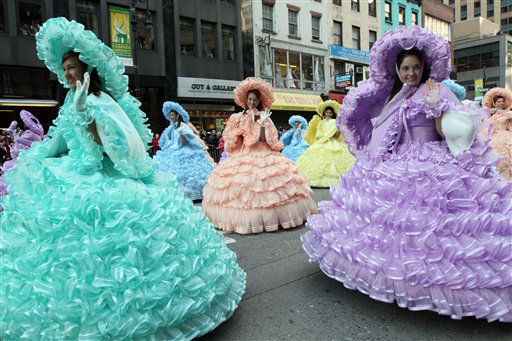Members of the Mobile Azalea Trail Maids wave as they make their way down New York&#39;s Sixth Avenue during the 85th Annual Macy&#39;s Thanksgiving Day Parade Thursday Nov. 24, 2011. The group is from Mobile, Alabama.  &#40;AP Photo&#47;Tina Fineberg&#41; <span class=meta>(AP Photo&#47; Tina Fineberg)</span>