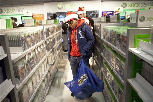 A customer shops for video games in the Toys R Us in Times Square in New York on Thursday, Nov. 24, 2011. The Toys R Us opened at 9PM offering special deals for holiday shoppers. &#40;AP Photo&#47;Andrew Burton&#41; <span class=meta>(AP Photo&#47; Andrew Burton)</span>