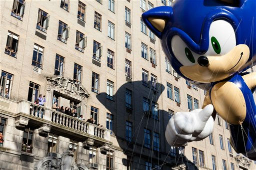 "<div class=""meta ""><span class=""caption-text "">A balloon of video game icon ""Sonic the Hedgehog"" passes spectators on a balcony during Macy's Thanksgiving Day Parade, Thursday, Nov. 24, 2011, in New York. A jetpack-wearing monkey and a freakish creation from filmmaker Tim Burton are two of the big new balloons that will make their inaugural appearances in front of millions of people at this year's parade. (AP Photo/John Minchillo) (AP Photo/ John Minchillo)</span></div>"