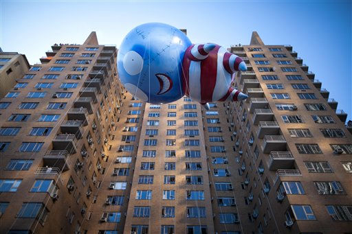 Filmmaker Tim Burton&#39;s B floats along 59th Street during Macy&#39;s Thanksgiving Day Parade, Thursday, Nov. 24, 2011, in New York. A jetpack-wearing monkey and Burton&#39;s freakish creation are two of the big new balloons that will make their inaugural appearances in front of millions of people at this year&#39;s parade. &#40;AP Photo&#47;John Minchillo&#41; <span class=meta>(AP Photo&#47; John Minchillo)</span>