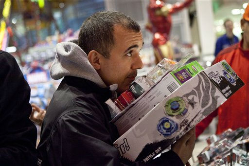 "<div class=""meta image-caption""><div class=""origin-logo origin-image ""><span></span></div><span class=""caption-text"">A customer attempts to hold a pile of items in the Toys R Us in Times Square in New York on Thursday, Nov. 24, 2011. The Toys R Us opened at 9PM offering special deals for holiday shoppers. (AP Photo/Andrew Burton) (AP Photo/ Andrew Burton)</span></div>"