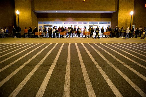 "<div class=""meta ""><span class=""caption-text "">Hundreds of shoppers wait in line for the midnight opening of a Target store in Roswell, Ga. on Friday, Nov. 25, 2011.  Black Friday began in earnest as stores opened their doors at midnight.  (AP Photo/Rich Addicks) (AP Photo/ Rich Addicks)</span></div>"