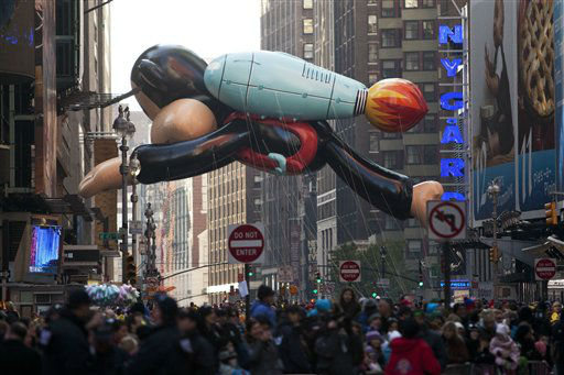 Julius, a jetpack-wearing monkey made by Paul Frank, floats during the Macy&#39;s Thanksgiving Day Parade in Times Square in New York on Thursday, Nov. 24, 2011. The parade premiered in 1924, this is its 85th year. &#40;AP Photo&#47;Andrew Burton&#41; <span class=meta>(AP Photo&#47; Andrew Burton)</span>