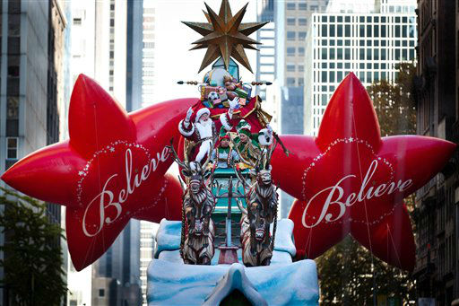 "<div class=""meta ""><span class=""caption-text "">Santa Claus waves at spectators during the Macy's Thanksgiving Day Parade, Thursday, Nov. 24, 2011, in New York. A jetpack-wearing monkey and a freakish creation from filmmaker Tim Burton are two of the big new balloons that will make their inaugural appearances in front of millions of people at this year's parade. (AP Photo/John Minchillo) (AP Photo/ John Minchillo)</span></div>"